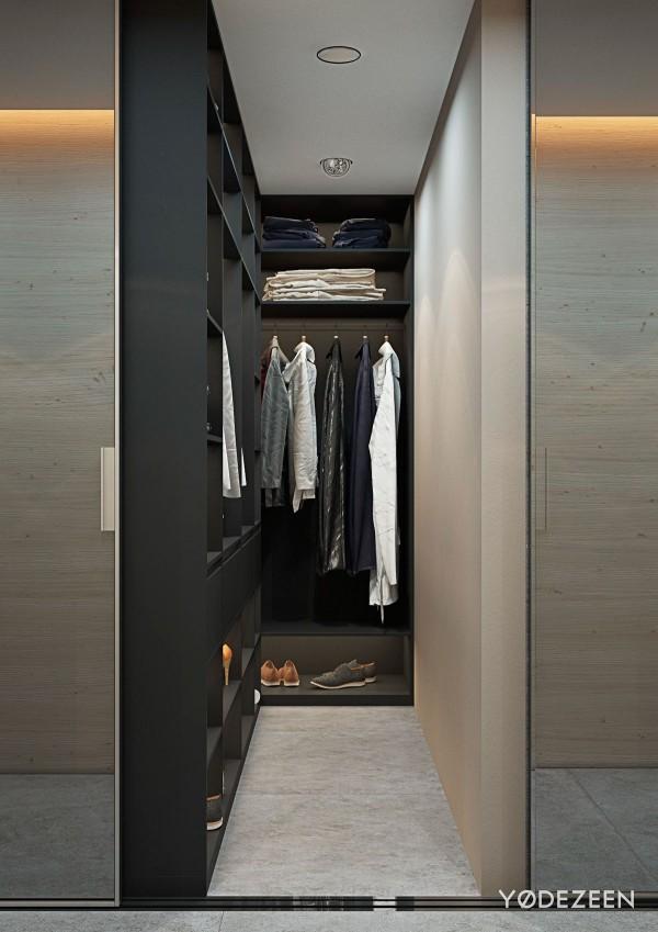 Khi trượt tấm kinh sẽ hé lộ 1 lối đi vào chiếc tủ quần áo nhỏ gọn được sơn màu đen mờ và màu kem