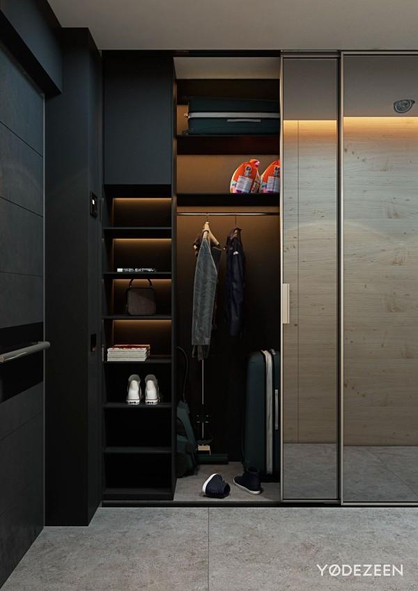 Phía gần cửa ra vào của căn hộ chung cư là 1 tủ quần áo ẩn phía sau 1 chiếc gương trượt.