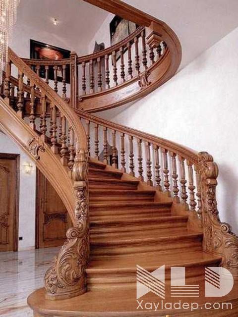 Ngay đầu tiên chính là mẫu cầu thang gỗ đẹp dành riêng cho các căn hộ, các căn biệt thứ với không gian rộng rãi.