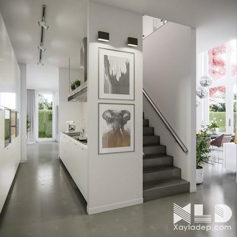 """Ngay sát phòng khách, một chiếc nhà bếp nhỏ gọn nằm """"khép mình"""" nơi hành là lựa chọn tuyệt vời cho không gian mở."""