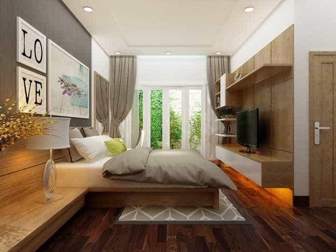 Phòng ngủ tông màu gỗ và xám nhạt mang lại cảm giác yên bình, thư thái.