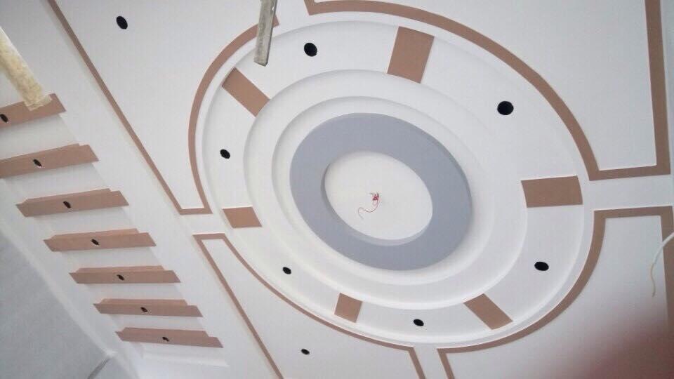 12. Thiết kế trần thạch cao phòng khách cầu kỳ