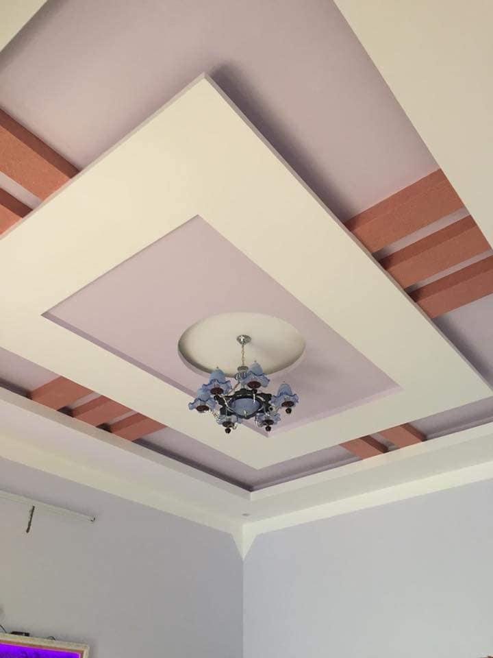 Mẫu 11: Mẫu trần nhà đẹp phòng khách nhà ống